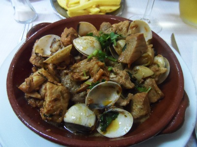 Pork chops cooked with clams. Yum!