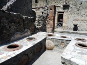 This used to be a bar. There were tons of these all around Herculaneum! Romans really loved their wine.