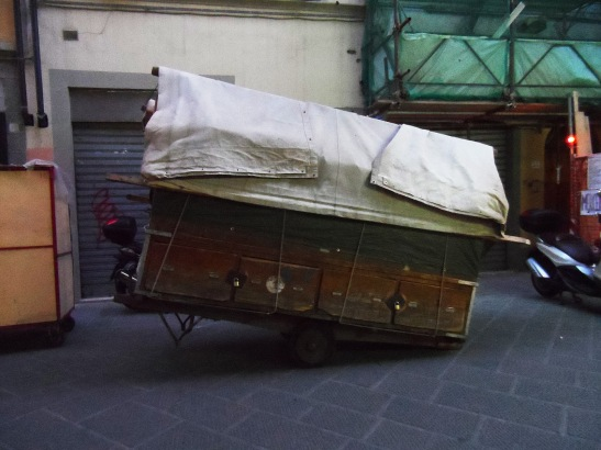 These old wooden merchant carts were so neat. Here is one all folded up ready to be rolled away.